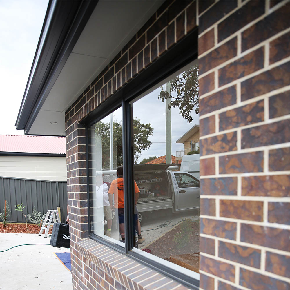 New Construction Brick Home: Auswide Building Group